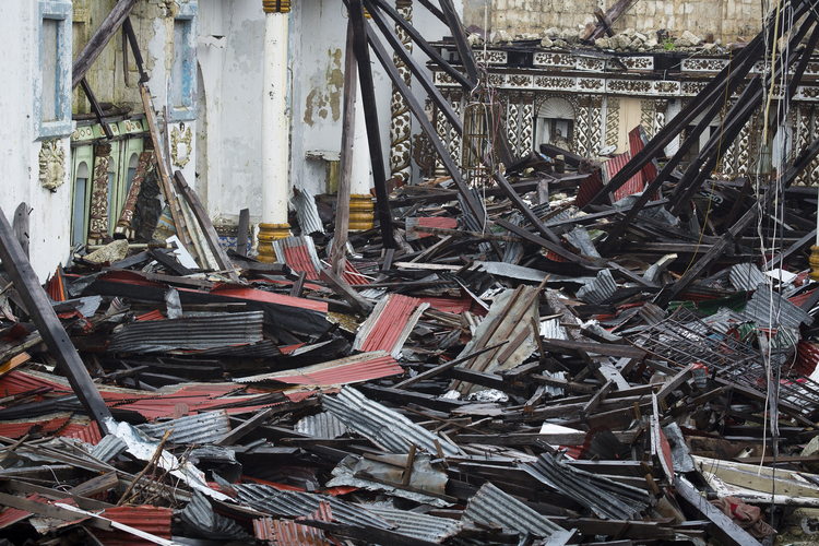 Metal roofing—remnants of November's Typhoon Haiyan—litters Immaculate Conception Church in Guiuan, Philippines, Feb. 9, 2014 (CNS photo/Tyler Orsburn).