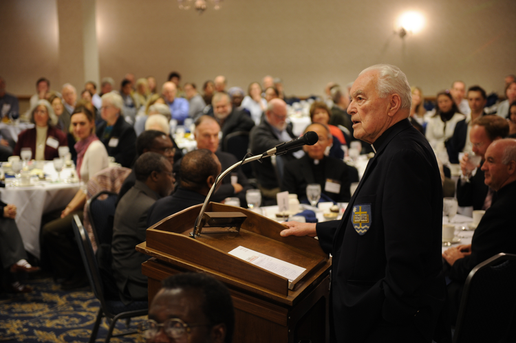 Hesburgh holds forth at a peace-building conference in 2008.