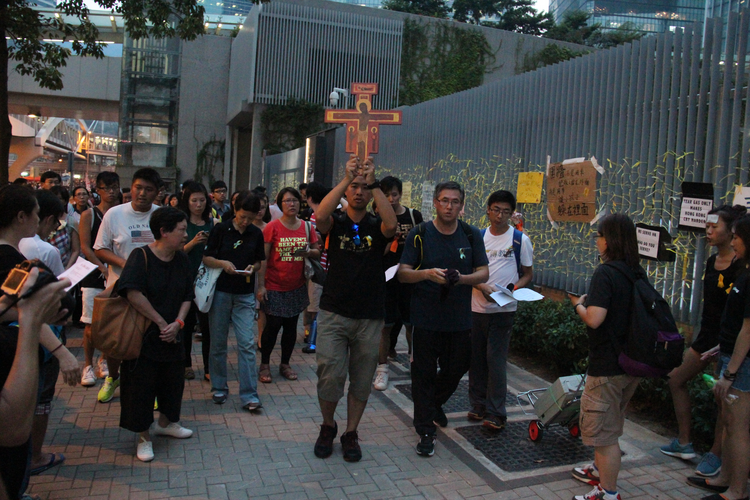 Catholic youths pray for democracy outside Hong Kong's government headquarters building on Sept. 30. (CNS photo/Francis Wong)