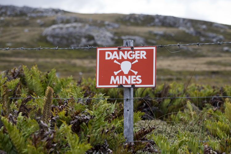 A warning sign marks one of the areas on the Falkland Islands not cleared of mines planted during the war with Great Britain  in 1982. (iStock/Gannet77)