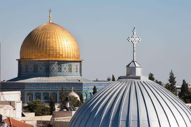 The silver dome of Our Lady of the Spasm Armenian Catholic Church and the golden Dome of the Rock rise over the Old City of Jerusalem. (iStock/rrodrickbeiler)