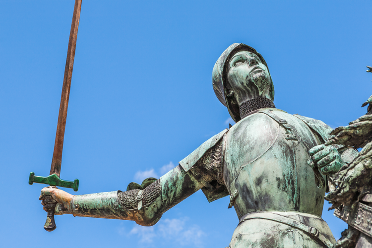 A bronze statue of Joan of Arc in the public space outside Reims Cathedral in France. (iStock/lucentius)