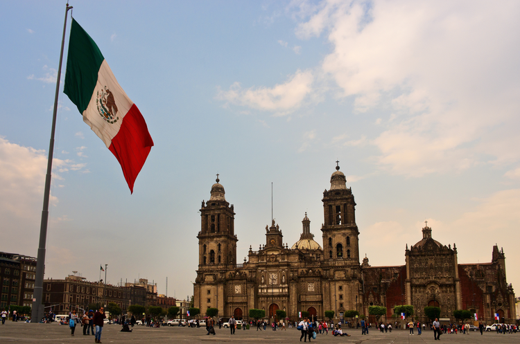 The Mexican Flag flies on the Zocalo near the Metropolitan Cathedral in Mexico City.