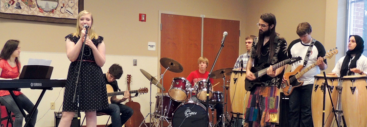 Austin Rose on drums with his band, Interfaith Rock