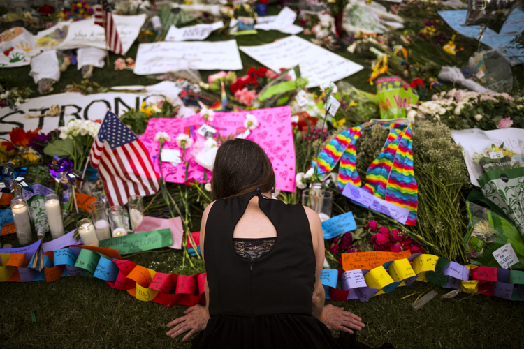 A woman visits a memorial in downtown Orlando, Fla., June 14, that honors the victims of the mass shooting at a gay nightclub. (CNS photo/John Taggart, EPA)