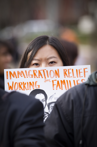 A woman holds a sign during an immigration rally in front of the White House, Nov. 19 (CNS photo/Tyler Orsburn).