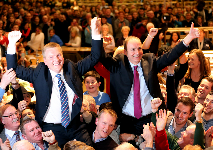 Fianna Fail Leader Micheal Martin, right, and Michael McGrath celebrate their party's strong showing at City Hall in Cork, Ireland on Feb. 27 (Chris Radburn/PA via AP).