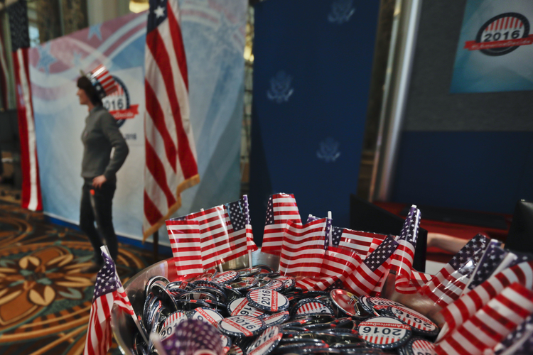 "Pins reading ""The America Decide"" are displayed during a reception organized by the U.S. Embassy to wait for the results of the 2016 U.S. Presidential election, in Rome, Tuesday, Nov. 8, 2016. (AP Photo/Gregorio Borgia)"