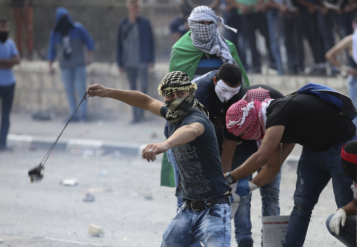 Palestinian protesters clash with Israeli soldiers in Bethlehem, West Bank, Oct. 6. Violence in Israel and the West Bank has increased in October.(CNS photo/Abed Al Haslhamoun, EPA)