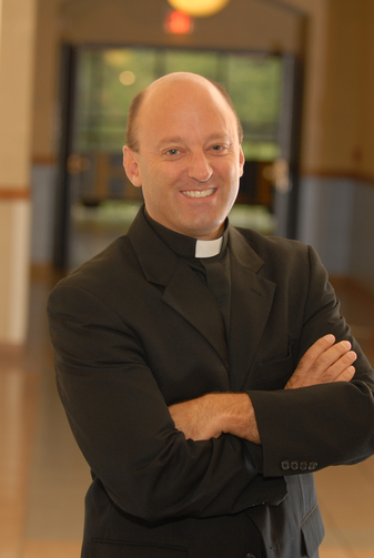 Father John Belmonte, S.J. (Diocese of Joliet)