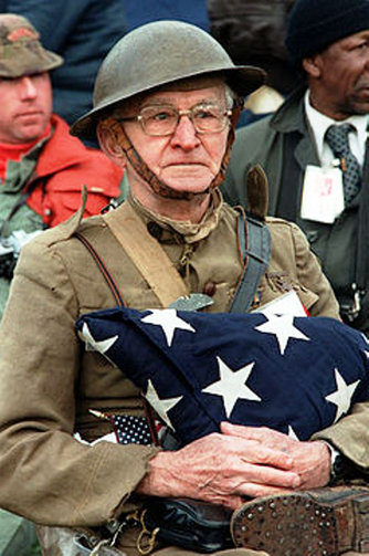 Joseph Ambrose, an 86-year-old World War I veteran, attends the dedication day parade for the Vietnam Veterans Memorial in 1982, holding the flag that covered the casket of his son, who was killed in the Korean War. (Courtesy, Wikipedia)
