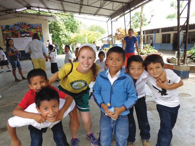 Julie with students at a school in the village of Las Delicias.