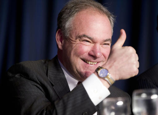 In this Feb. 4, 2016, file photo, Sen. Tim Kaine, D-Va., gives a 'thumbs-up' as he takes his seat at the head table for the National Prayer Breakfast in Washington. (AP Photo/Pablo Martinez Monsivais, File)