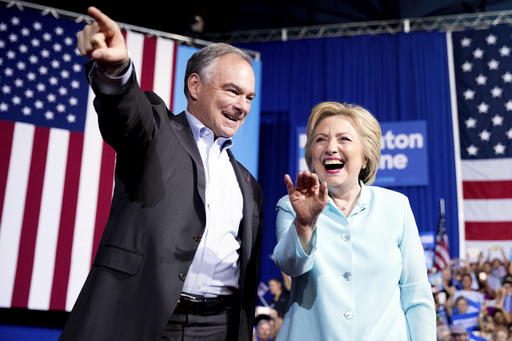 Democratic presidential candidate Hillary Clinton and Sen. Tim Kaine, D-Va., arrive at a rally at Florida International University Panther Arena in Miami, Saturday, July 23, 2016. (AP Photo/Andrew Harnik)