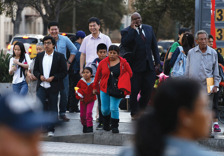 PROMISES TO KEEP. People stand at an intersection in Koreatown, one of several neighborhoods designated by the Obama administration as a promise zone in Los Angeles, Calif., Jan. 22, 2014.