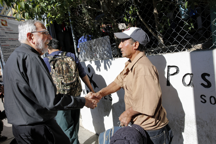 Bishop Gerald F. Kicanas of Tucson greets men entering the Kino Border Initiative soup kitchen Nogales, in northern Mexico, in 2014