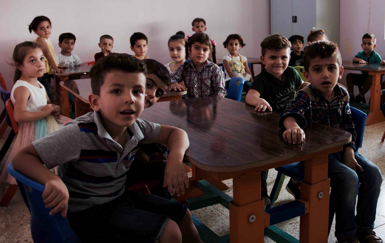 Image: Students attend a new kindergarten in Qaraqosh, Iraq. (Kevin Clarke)