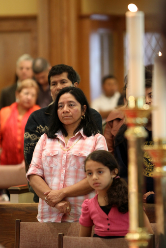 Latino worshippers stand during a special Mass honoring immigrants at St. John the Evangelist Church in Riverhead, N.Y., in 2011. (CNS photo/Gregory A. Shemitz, Long Island Catholic)