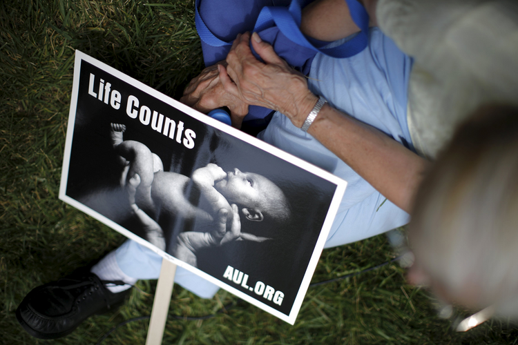 "Life Counts at a ""Women Betrayed"" rally to Defund Planned Parenthood on Capitol Hill in Washington July 28. (CNS photo/Carlos Barria, Reuters)"