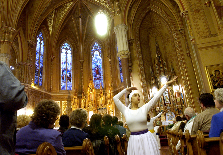 Liturgical dancers prepare the congregation for worship at St. Michael's Church in Rochester, N.Y., April 6, 2004.