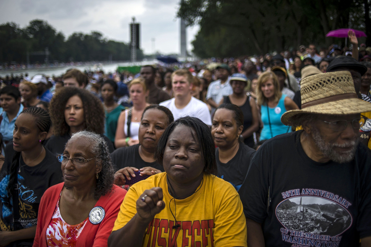 People gather around the reflecting pool of the Lincoln Memorial for the ceremony marking the 50th anniversary of the March on Washington Aug. 28. (CNS photo/James Lawler Duggan, Reuters)