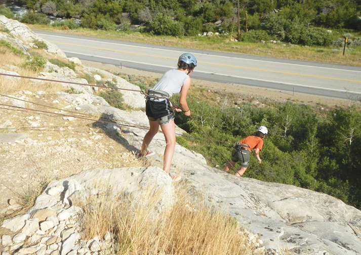 CLIFFHANGER. The author, right, rappelling Australian style near Wyoming Catholic College.