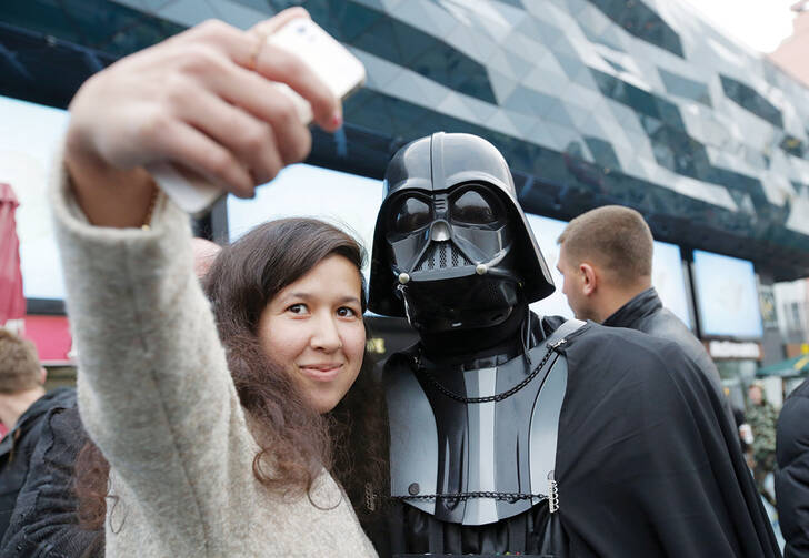 STAR WARS SELFIE. Ukrainian woman poses with a person dressed as Darth Vader.