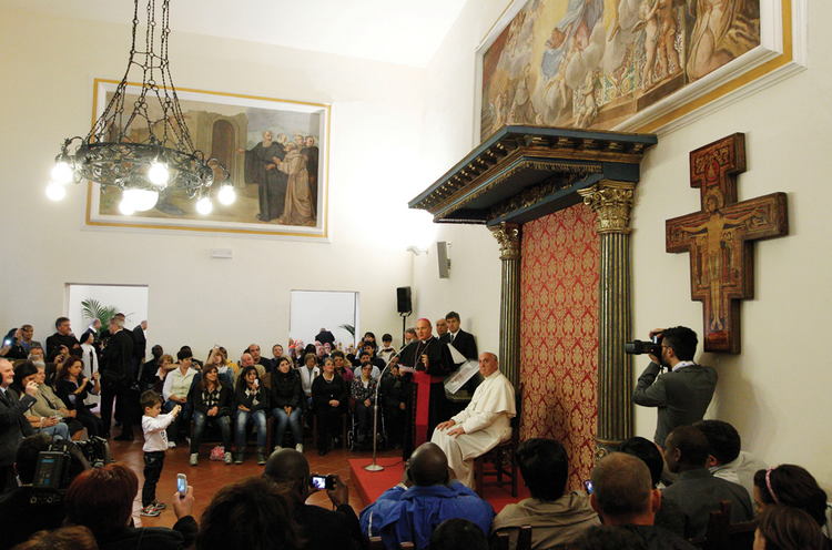 NAMESAKE. Pope Francis leads a meeting with the poor in the archbishop's residence in Assisi, Italy, Oct. 4.