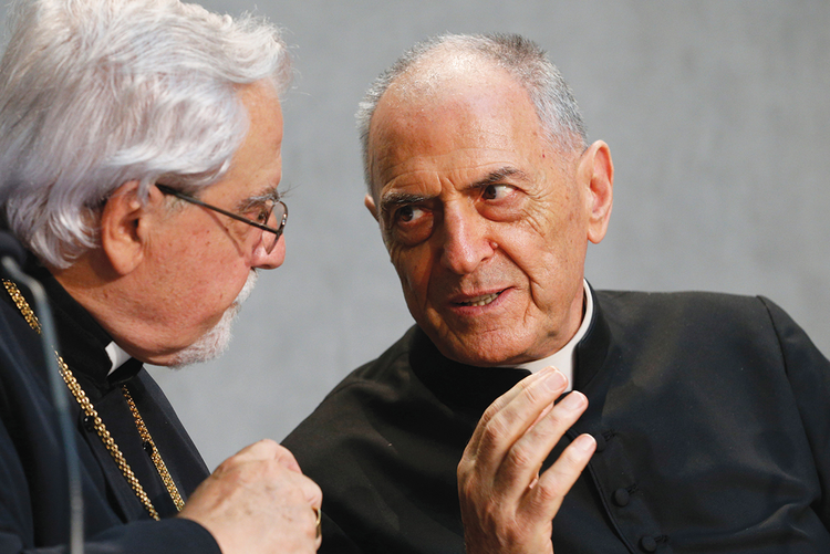 MARRIAGE COUNSELORS. Bishop Dimitrios Salachas of Greece, left, talks with Msgr. Pio Vito Pinto, dean of the Roman Rota, a Vatican court.