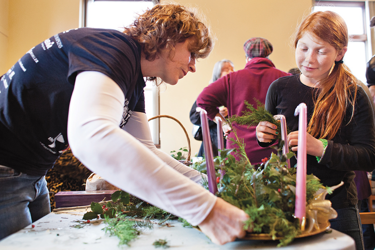 Denise Alexander and Madison Craig put the finishing touches on an Advent wreath at the Shrine of St. Anthony in Ellicott City, Md., Nov. 30.
