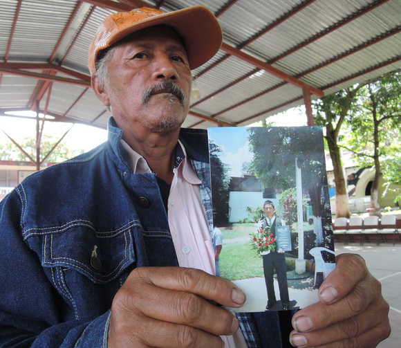 Father of missing student displays photo in Mexico