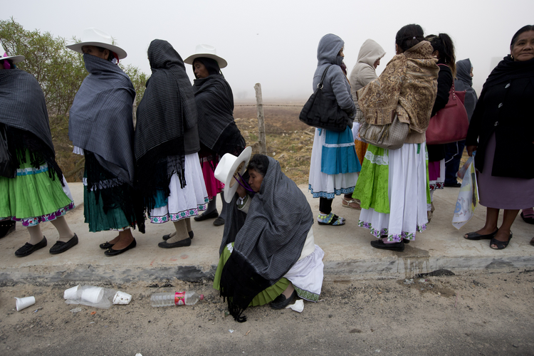 Women wait to enter to the site where Pope Francis will celebrate Mass during his one-day visit in San Cristobal de las Casas, Mexico, early Monday, Feb. 15, 2016. (AP Photo/Moises Castillo)