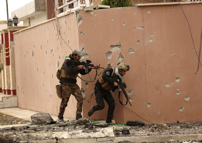 Soldiers with Iraq's elite counterterrorism forces secure houses and streets during fighting against Islamic State militants to regain control of the eastern neighborhoods of Mosul, Iraq, Tuesday, Dec. 13, 2016. (AP Photo/Hadi Mizban)
