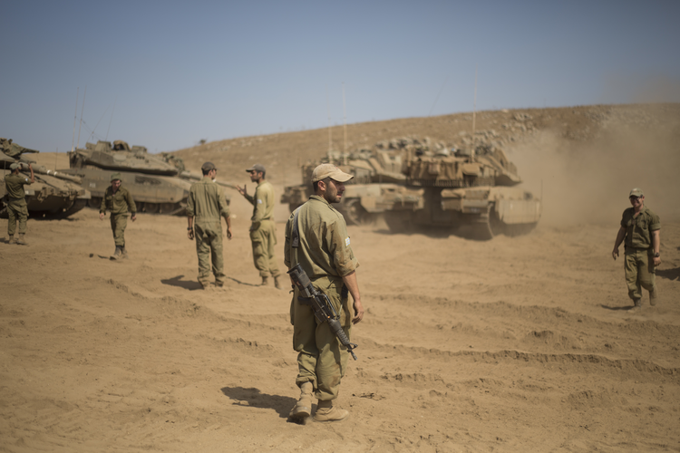 Israeli soldiers gather next to tanks during training in the Israeli-controlled Golan Heights, near the border with Syria, on Sept. 13. (AP Photo/Ariel Schalit)