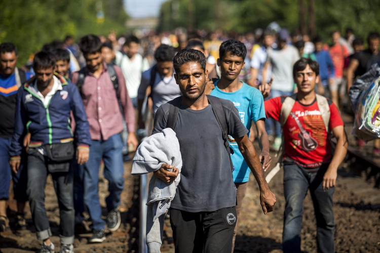 Migrants walk on the railway tracks in Bicske, Hungary, near the Austrian border Sept. 4.