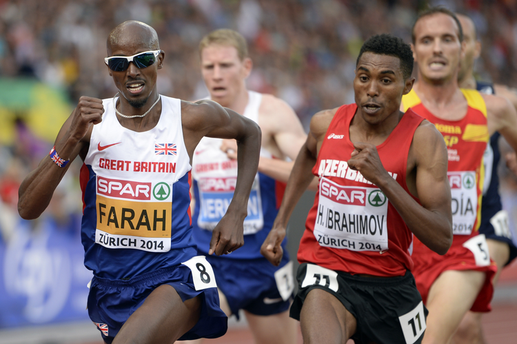 Mo Farah of Great Britain, left, competes in the men's 5,000- meter final during the European Athletics Championships in Zurich, Switzerland Aug. 17, 2014. (CNS photo/Jean-Christophe Bott, EPA)