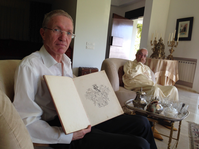 Hassan Bargach at his home in Rabat, Morocco on June 4, 2014, showing the book presented to his family by the Spanish government tracing its roots to the Iberian town of Hornachos. Photo by Gil Shefler.