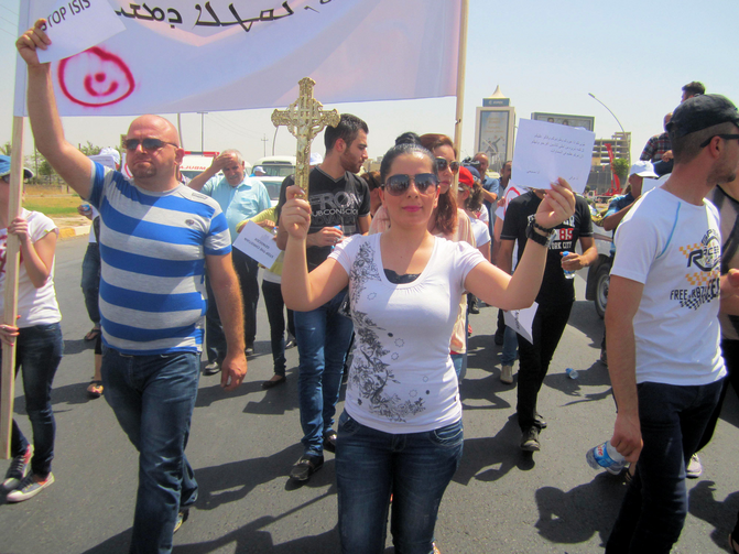 Christian refugees march against persecution by Islamic State fighters outside the U.N. compound near the airport in Irbil, Iraq, July 24. Christians braved temperatures as high as 122 degrees Fahrenheit to make their voices heard.