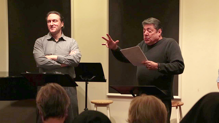 "George Drance, S.J., left, as the Narrator and Richard Zavaglia as Stevens in a staged reading of ""Mr. Blue."""