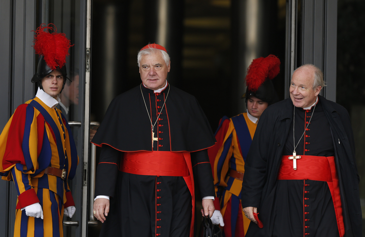 Cardinal Gerhard Muller, prefect of the Congregation for the Doctrine of the Faith, and Austrian Cardinal Christoph Schonborn of Vienna leave a session of the Synod of Bishops on the family at the Vatican, Oct. 14 (CNS photo/Paul Haring).
