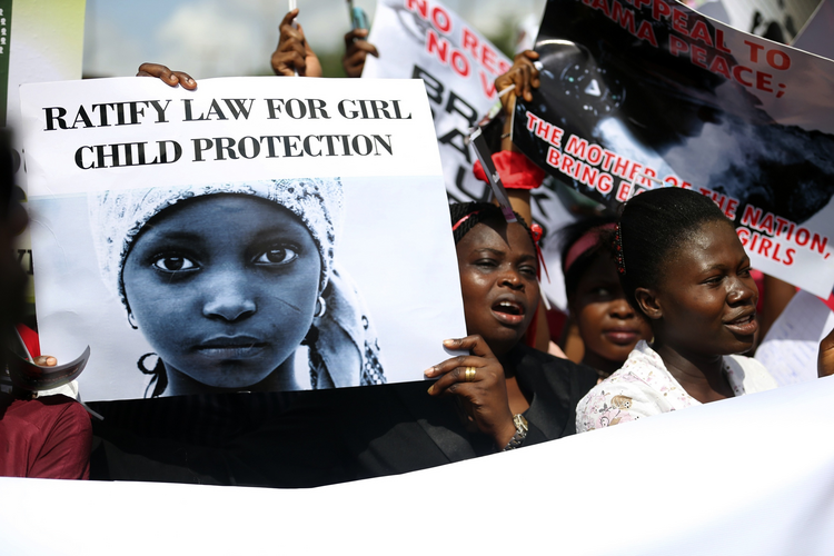 A protest in Lagos, Nigeria, last May to demand the release of abducted high school girls. (CNS photo/Akintunde Akinleye, Reuters)