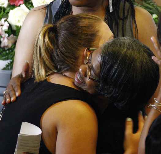 A Lexington, Miss., resident hugs a relative of Sister Margaret Held, following a vigil for Held and Sister Paula Merrill at St. Thomas Catholic Church in Lexington, Miss., on Aug. 28. (AP Photo/Rogelio V. Solis)