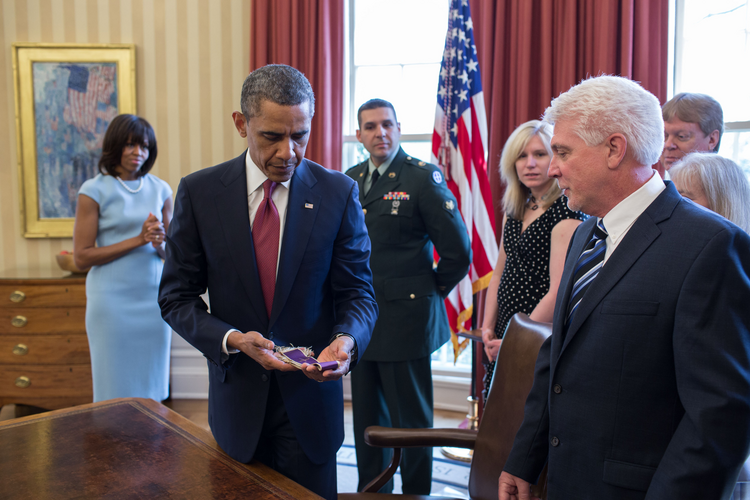 President Obama holds stole that belonged to Father Emil Kapaun.