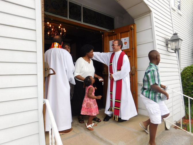 The Rev. Kazimierz Bem greets worshippers leaving First Church in Marlborough, Mass., following an ecumenical prayer service on June 3 (Photo: First Church/Barbara Parente).