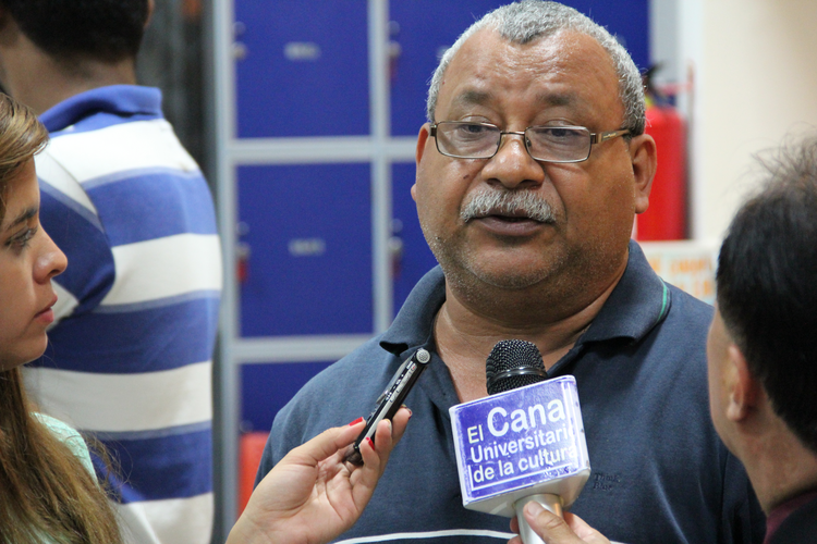 Padre Melo speaks to reporters at the National Autonomous University of Honduras in Tegucigalpa on Sept. 11, 2013.