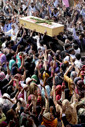 Pakistani Christians carry a coffin of a church bombing victim in Lahore, Pakistan, March 17.