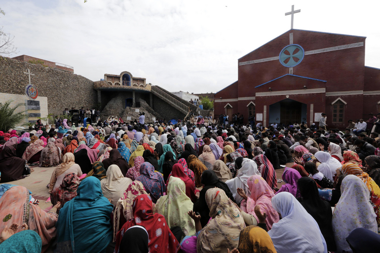 Pakistani Christians gather at a church March 16 to protest two suicide attacks on churches in Lahore. (CNS photo/Rahat Dar, EPA)