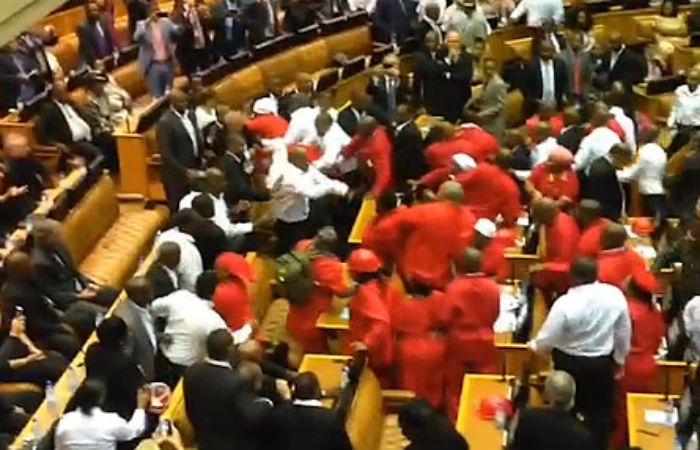 Members of the Economic Freedom Fighters being removed from the South African Parliament.