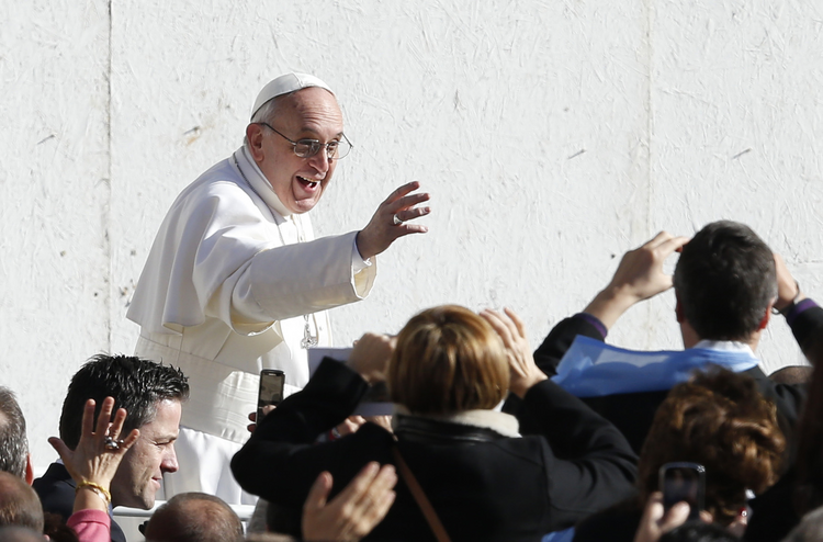 Pope Francis greets people before celebrating inaugural Mass in St. Peter's Square at Vatican. CNS Photo/Paul Haring