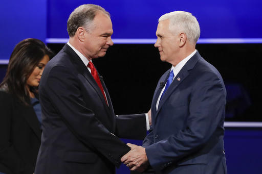 Republican vice-presidential nominee Gov. Mike Pence, right, and Democratic vice-presidential nominee Sen. Tim Kaine shake hands during the vice-presidential debate at Longwood University in Farmville, Va., Oct. 4 (AP Photo/David Goldman).